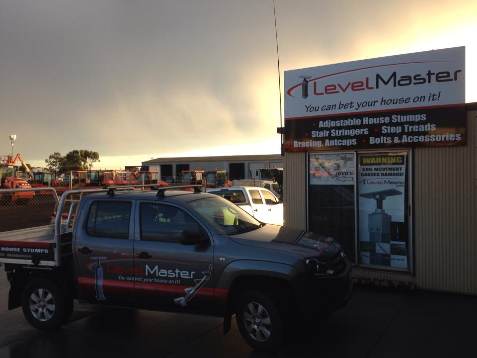 LevelMaster Office and LevelMaster ute. Sign says 'LevelMaster: You Can Bet Your House On It'.
